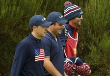 U.S. Ryder Cup players Jordan Speith (L) and Patrick Reed (C) walk with Spieth's caddie Michael Greller  during their foursomes 40th Ryder Cup match at Gleneagles in Scotland September 27, 2014.  REUTERS/Phil Noble (BRITAIN  - Tags: SPORT GOLF)