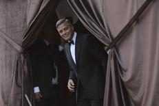 U.S. actor George Clooney smiles as he arrives by taxi boat to the venue of a gala dinner ahead of his official wedding ceremony in Venice September 27, 2014. REUTERS/Alessandro Bianchi