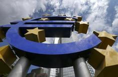 A huge euro logo is pictured next to the headquarters of the European Central Bank (ECB) before the bank's monthly news conference in Frankfurt August 7, 2014.  The European Central Bank left interest rates unchanged on Thursday, holding off fresh policy action as it prepares to launch fresh funding for banks next month that it hopes will lift inflation from rock-bottom levels.     REUTERS/Ralph Orlowski  (GERMANY - Tags: BUSINESS POLITICS) - RTR41KE0
