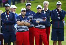 Team U.S. players (2nd L-R) Patrick Reed, Bubba Watson and Jordan Speith watch as Team Europe golfer Jamie Donaldson hits his ball onto the 15th green in his match against U.S. player Keegan Bradley during the 40th Ryder Cup singles golf matches at Gleneagles in Scotland September 28, 2014.   REUTERS/Eddie Keogh