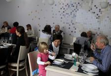 Guests sit in Izlelo, a restaurant in Szekszard, south of Budapest, September 22, 2014. REUTERS/Bernadett Szabo