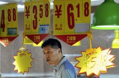 A man looks at a price tag as he shops at a supermarket in Hefei, Anhui province September 11, 2014. REUTERS/Stringer