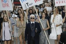 German designer Karl Lagerfeld appears with models who stage a demonstration at the end of his Spring/Summer 2015 women's ready-to-wear collection for French fashion house Chanel during Paris Fashion Week September 30, 2014.    REUTERS/Gonzalo Fuentes