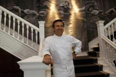 America's preeminent French chef Daniel Boulud poses in his restaurant in Beijing August 15, 2008.  REUTERS/Jason Reed/Files