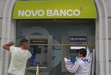 Workers install the new logo of Portuguese Novo Banco (New Bank) at their Lisbon office September 22, 2014. REUTERS/Hugo Correia