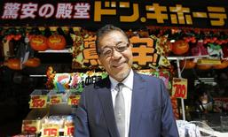 Japanese discount store operator Don Quijote Holdings CEO Takao Yasuda poses for a photo at Don Quijote's central branch store in Tokyo in this September 30, 2014 file photo. REUTERS/Toru Hanai/Files