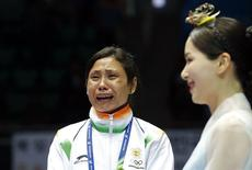 India's bronze medallist Laishram Sarita Devi reacts during the medal ceremony for the women's light (57-60kg) boxing competition at the Seonhak Gymnasium during the 2014 Asian Games in Incheon October 1, 2014. REUTERS/Kim Kyung-Hoon