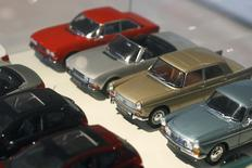 Peugeot miniature model vintage cars are lined-up in the store at French carmaker PSA Peugeot Citroen headquarters in Paris in this February 13, 2013 file photo. REUTERS/Charles Platiau/Files