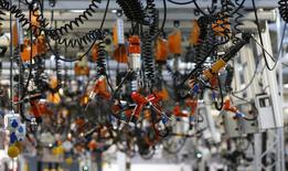 La dégradation de la demande en dépit de la modération des prix a pesé sur l'activité du secteur manufacturier en septembre dans la majeure partie de l'Asie et de l'Europe, suggérant un ralentissement de la croissance mondiale au cours des prochains mois. /Photo prise le 9 septembre 2014/REUTERS/Kai Pfaffenbach