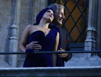 U.S. singers Lady Gaga and Tony Bennett (R) pose on the balcony of Brussels townhall after a news conference, ahead of their concert, at Brussels Grand Place September 22, 2014.  REUTERS/Yves Herman