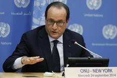 France's President Francois Hollande speaks to members of the media during a news briefing at the United Nations headquarters in New York September 24, 2014. REUTERS/Eduardo Munoz