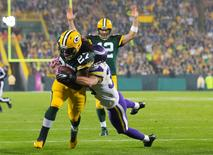 Oct 2, 2014; Green Bay, WI, USA; Green Bay Packers running back Eddie Lacy (27) rushes for a touchdown during the third quarter against the Minnesota Vikings at Lambeau Field.   Jeff Hanisch-USA TODAY Sports