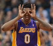 Feb 4, 2014; Minneapolis, MN, USA; Los Angeles Lakers forward Nick Young (0) celebrates his three pointer in the fourth quarter against the Minnesota Timberwolves at Target Center. Minnesota wins 109-99. Mandatory Credit: Brad Rempel-USA TODAY Sports
