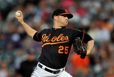 Sep 12, 2014; Baltimore, MD, USA; Baltimore Orioles starting pitcher Bud Norris (25) pitches in the first inning against the New York Yankees in game two of a doubleheader at Oriole Park at Camden Yards. Mandatory Credit: Joy R. Absalon-USA TODAY Sports