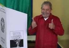 Brazil's former President Luiz Inacio Lula da Silva gestures after casting his vote during presidential elections, in his hometown city of Sao Bernardo do Campo, near Sao Paulo October 5, 2014. Brazilians will vote in the first round of general elections on Sunday. REUTERS/Nacho Doce (BRAZIL - Tags: POLITICS ELECTIONS)