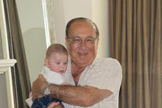 Canadian transport executive Cy Tokmakjian holds his grandson Christian in an undated family photo released to Reuters in Toronto, September 29, 2014.   REUTERS/Raffi Tokmakjian/Handout via Reuters