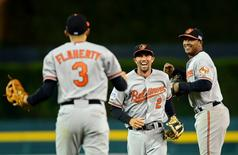 Oct 5, 2014; Detroit, MI, USA; Baltimore Orioles shortstop J.J. Hardy (2), third baseman Ryan Flaherty (3) and second baseman Jonathan Schoop (6) celebrate after defeating the Detroit Tigers in game three of the 2014 ALDS baseball playoff game at Comerica Park. The Orioles move on to the ALCS with 2-1 win over the Tigers. Mandatory Credit: Andrew Weber-USA TODAY Sports