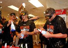 Oct 5, 2014; Detroit, MI, USA; Baltimore Orioles players celebrate their win in the locker room after defeating the Detroit Tigers in game three of the 2014 ALDS baseball playoff game at Comerica Park. The Orioles move on to the ALCS with 2-1 win over the Tigers. Mandatory Credit: Rick Osentoski-USA TODAY Sports