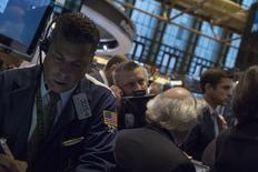 Traders work on the floor of the New York Stock Exchange October 3, 2014. REUTERS/Brendan McDermid