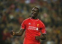 Atacante do Liverpool Mario Balotelli comemora gol marcado contra Ludogorets na Liga dos Campeões. 16/09/2014 REUTERS/Phil Noble