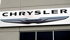 The Chrysler logo is seen outside the Chrysler auto dealer in Broomfield, Colorado October 1, 2014.REUTERS/Rick Wilking