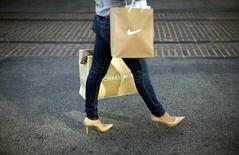 A woman shops at The Grove mall in Los Angeles November 26, 2013. REUTERS/Lucy Nicholson