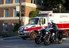 An ambulance transports Ashoka Mukpo, a freelance cameraman who contracted Ebola in Liberia, to the Nebraska Medical Center in Omaha, Nebraska, October 6, 2014.  REUTERS/Sait Serkan Gurbuz