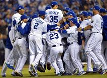 Oct 5, 2014; Kansas City, MO, USA; The Kansas City Royals celebrate after defeating the Los Angeles Angels in game three of the 2014 ALDS baseball playoff game at Kauffman Stadium. Mandatory Credit: Peter G. Aiken-USA TODAY Sports