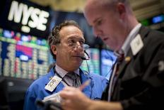 Traders work on the floor of the New York Stock Exchange October 1, 2014. REUTERS/Brendan McDermid