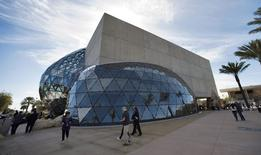 Visitors walk outside the new Dali Museum during the grand opening and dedication for the museum in St. Petersburg, Florida, in this January 11, 2011 file photo.  REUTERS/Steve Nesius
