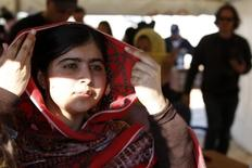 Pakistani teenage activist Malala Yousafzai leaves after speaking at a news conference at the Zaatri refugee camp, in the Jordanian city of Mafraq, near the border with Syria February 18, 2014. REUTERS/Muhammad Hamed