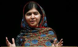 Pakistani schoolgirl Malala Yousafzai, the joint winner of the Nobel Peace Prize, speaks at Birmingham library in Birmingham, central England October 10, 2014. REUTERS/Darren Staples