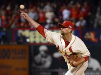 Oct 11, 2014; St. Louis, MO, USA; St. Louis Cardinals starting pitcher Adam Wainwright throws a pitch against the San Francisco Giants in the first inning in game one of the 2014 NLCS playoff baseball game at Busch Stadium. Jeff Curry-USA TODAY Sports