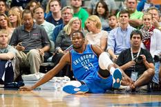 Oct 10, 2014; Dallas, TX, USA; Oklahoma City Thunder forward Kevin Durant (35) is knocked to the floor during the first half against the Dallas Mavericks at the American Airlines Center. Mandatory Credit: Jerome Miron-USA TODAY Sports