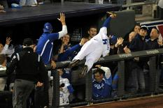 Oct 14, 2014; Kansas City, MO, USA; Kansas City Royals third baseman Mike Moustakas (8) dives into the stands to catch a foul ball hit by Baltimore Orioles center fielder Adam Jones (not pictured) during the sixth inning in game three of the 2014 ALCS playoff baseball game at Kauffman Stadium. Denny Medley-USA TODAY Sports