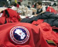 Workers piece together outerwear on the manufacturing floor of Canada Goose's facility in Toronto in this file photo from January 17, 2012. REUTERS/Fred Thornhill/Files