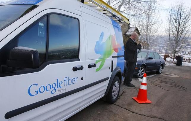A technician gets cabling out of his truck to install Google Fiber in a residential home in Provo, Utah, January 2, 2014. REUTERS/George Frey