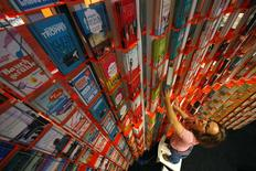 A woman sorts books at a booth during preparations for the upcoming book fair in Frankfurt, October 7, 2014. REUTERS/Ralph Orlowski