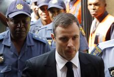 South African Olympic and Paralympic sprinter Oscar Pistorius  arrives at the North Gauteng High Court in Pretoria, October 16, 2014.  REUTERS/Mike Hutchings