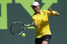 Mar 19, 2014; Miami, FL, USA; Nikolay Davydenko hits a forehand against Adrian Mannarino (not pictured) on day three of the Sony Open at Crandon Tennis Center. Mandatory Credit: Geoff Burke-USA TODAY Sports