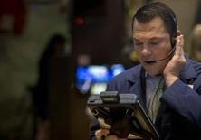 A trader works on the floor of the New York Stock Exchange October 16, 2014. REUTERS/Brendan McDermid