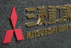 Japan's Mitsubishi Heavy Industries' logo is pictured outside the company headquarters in Tokyo December 17, 2012. REUTERS/Yuriko Nakao