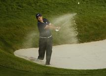 U.S. Ryder Cup player Patrick Reed hits out of a bunker on the 18th hole during his foursomes 40th Ryder Cup match at Gleneagles in Scotland September 27, 2014.        REUTERS/Phil Noble (BRITAIN  - Tags: SPORT GOLF)
