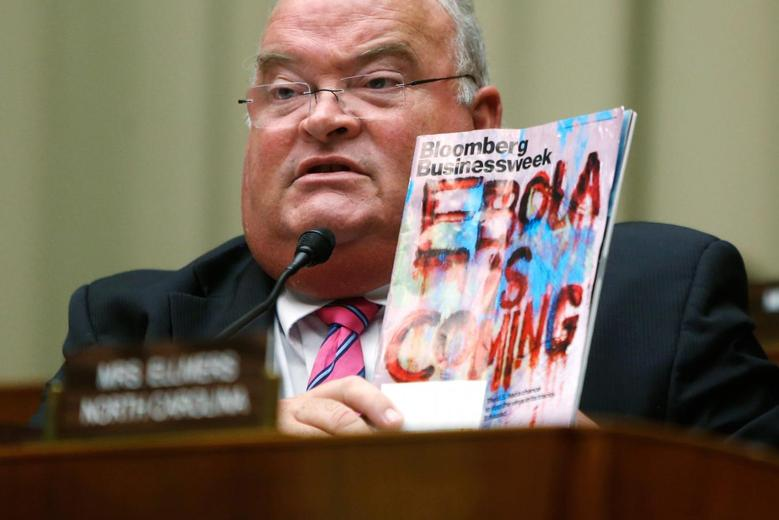 U.S. Representative Billy Long (R-MO) holds up a copy of a magazine with an Ebola headline as public health officials testify before a House Energy and Commerce Oversight and Investigations Subcommittee hearing on the U.S. response to the Ebola crisis, in Washington October 16, 2014.  REUTERS/Jonathan Ernst