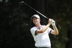 Sep 11, 2014; Atlanta, GA, USA; Webb Simpson tees off on the third hole during the first round of the Tour Championship at East Lake Golf Club. Mandatory Credit: Brett Davis-USA TODAY Sports