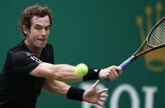 Andy Murray of Britain returns a shot during his men's singles tennis match against David Ferrer of Spain at the Shanghai Masters tennis tournament in Shanghai October 9, 2014. REUTERS/Aly Song