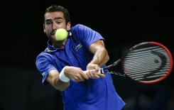 Croatia's Marin Cilic hits a return against Kazakhstan's Mikhail Kukushkin during their Kremlin Cup men's semi-final tennis match in Moscow October 18, 2014.  REUTERS/Grigory Dukor