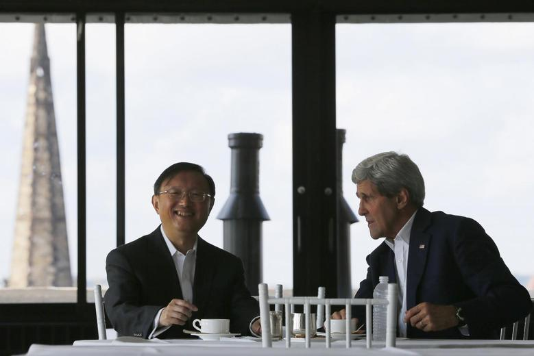 China's State Councillor Yang Jiechi (L) and U.S. Secretary of State John Kerry talk over tea during a day of meetings in Boston, Massachusetts October 18, 2014.      REUTERS/Brian Snyder