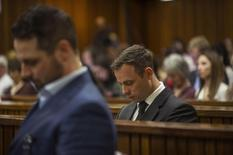 Olympic and Paralympic track star Oscar Pistorius attends his sentencing hearing at the North Gauteng High Court in Pretoria October 17, 2014. REUTERS/Mujahid Safodien/Pool