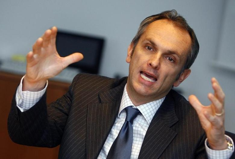 File photo of Luca Maestri during an exclusive interview at the Reuters Auto Summit in Frankfurt November 19, 2007. REUTERS/Alex Grimm/Files